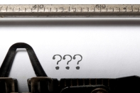 Typewriter with questions marks