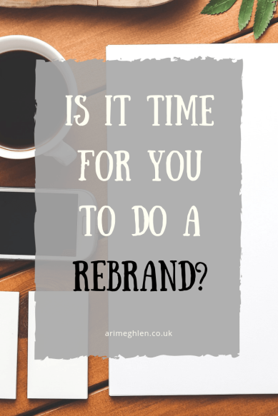 Title Image: Is it time for you to do a rebrand. Image: Desk with paper, coffee, phone and business cards