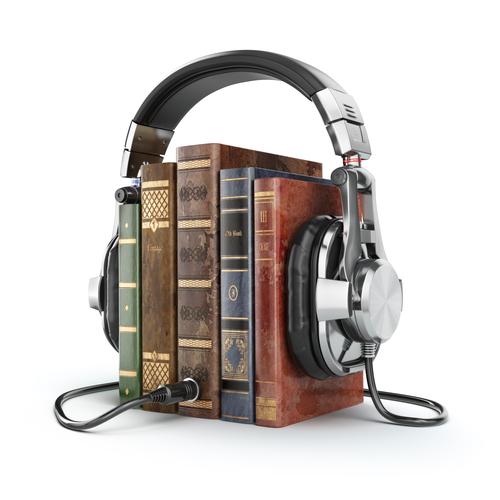 Audio books concept. Vintage books and headphones.